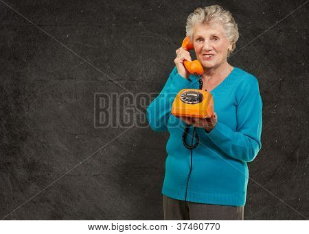 Mature Woman, Talking On Telephone, Indoor