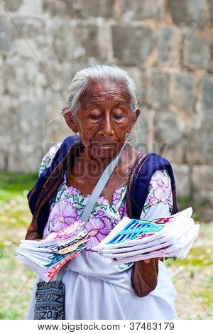 Elderly Woman Selling Traditional Mayan Handkerchiefs And Napkins