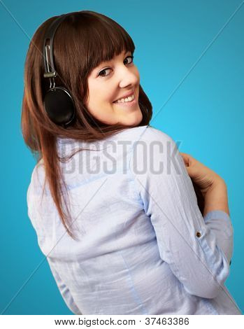 Happy Woman Wearing Headphone Isolated On Blue Background