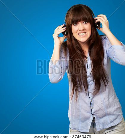 Woman Wearing Headphone Isolated On Blue Background