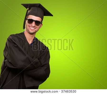 Happy Graduate Man Isolated On Green Background