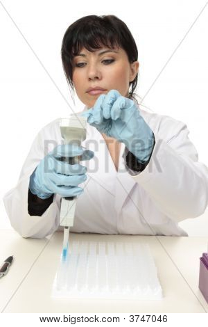 Scientist Working With Pipette