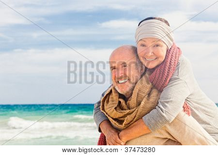 happy senior couple hugging enjoying retirement