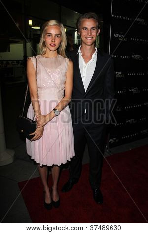 LOS ANGELES - OCT 2:  Isabel Lucas, Rhys Wakefield arrives at the