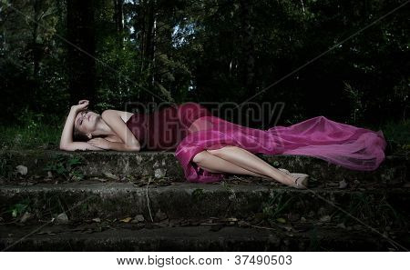 Nocturnal Scene In Park With Lying Pretty Nymph In Crimson Dress