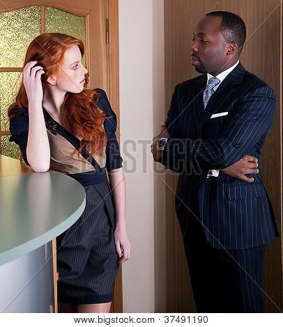 Two Businesspeople Female And Male Standing In Office