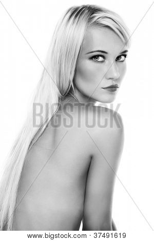 Black and white shot of beautiful slim sexy blonde girl on white background