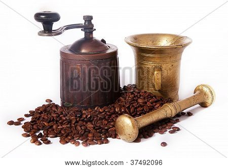 Old Brass Coffee Grinder And Coffee Beans