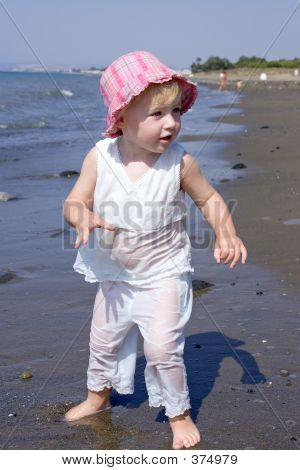 Young Girl Playing On Beach