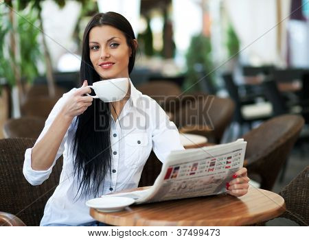 Young girl reading a newspaper during the job break