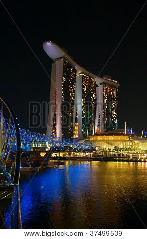 SINGAPORE - FEBRUARY 22: The Marina Bay Sands complex at night on February 22, 2012 in Singapore. Marina Bay Sands is integrated resort billed as the world's most expensive standalone casino property.