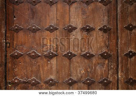 old wooden door with metal ornate background