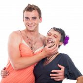 stock photo of transvestite  - Two laughing transvestites having fun isolated on white background - JPG