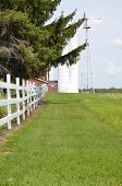 foto of split rail fence  - Fence on a rural farm dividing home and pasture - JPG