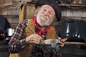 image of saucepan  - Classic old western style cowboy cook with felt hat grey whiskers red bandana - JPG