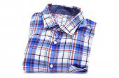 pic of cross-dressing  - a folded plaid patterned shirt on a white background - JPG