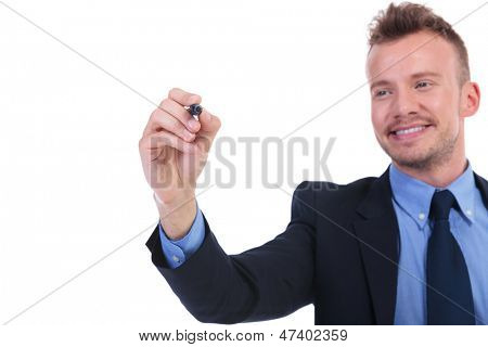 young business man writing something with his marker on an imaginary screen while looking at it. on white background
