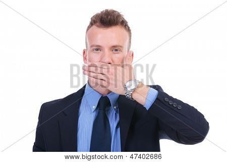 young business man covering his mouth with his hand. speak no evil. on white background