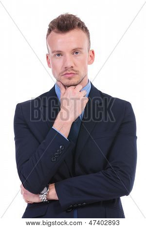 young business man standing with his hand on his chin and looking thoughtful. on white background