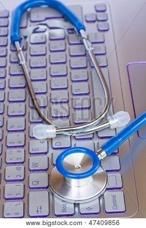 stethoscope on notebook keyboard