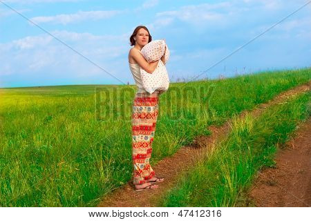 Slender Young  Woman With Pillow