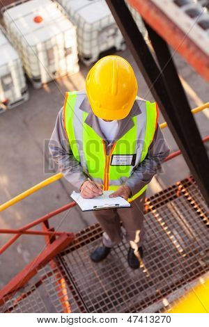senior oil chemical worker working in refinery plant
