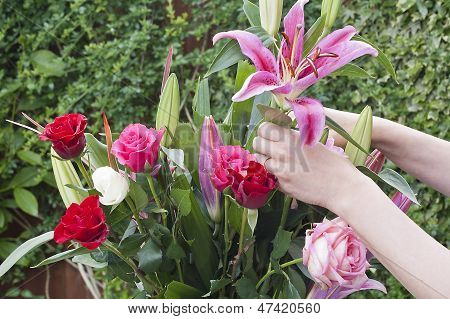 Woman Arranging A Bouquet Of Flowers