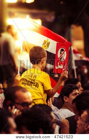 A Little Boy Protesting Against Morsy