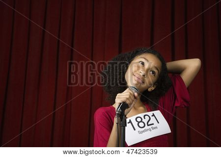 Little girl wearing number on stage