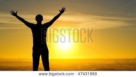Silhouette Of Man On The Field In The Morning At Sunrice