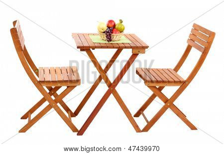 Wooden table with fruit isolated on white