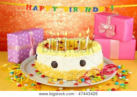 Happy birthday cake and gifts, on red background