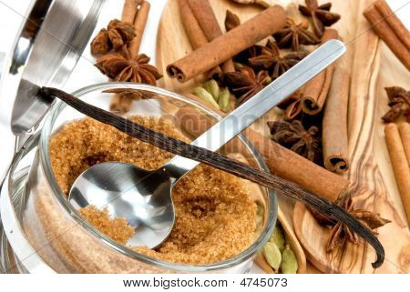 Cinnamon Sticks,Cardamom,Vanilla Bean And Star Anise On White - Tight Depth Of Field