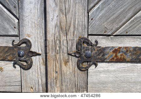 Wrought Iron Door Hinge On Old Wooden Background