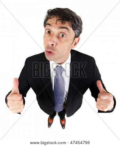 Fun high angle portrait with diminishing perspective of a motivated man giving a double thumbs up gesture of approval and success isolated on white