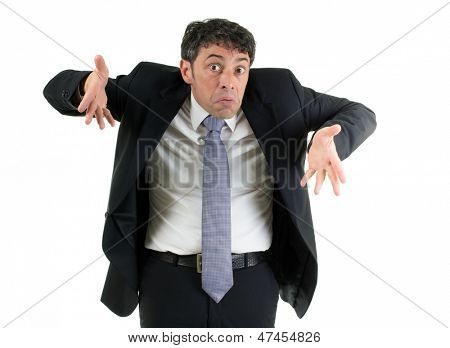 Expressive businessman shrugging his shoulders in ignorance or indifference and gesturing with his hands isolated on white