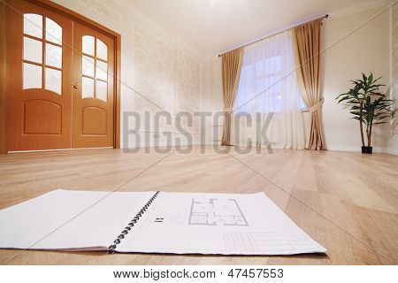 Drawing of apartment on floor in simple room with window in new apartment.