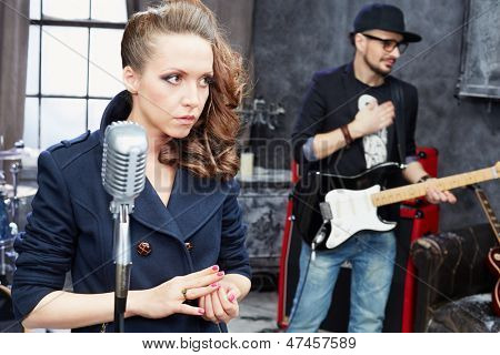 Female lead vocal and guitarist in studio