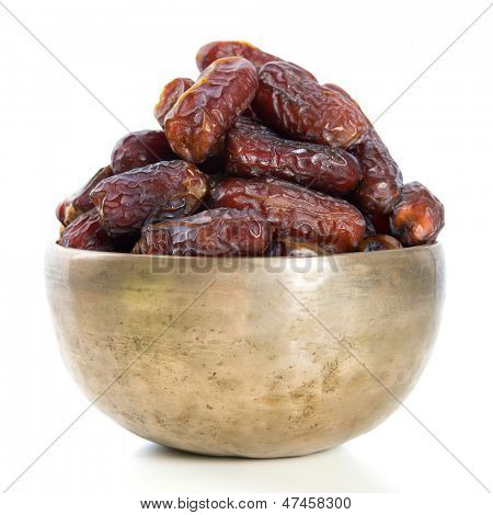 Dates.  Kurma dried date palm fruits, Ramadan food which eaten in fasting month for Muslim. Pile of fresh dried date fruits in a bowl.