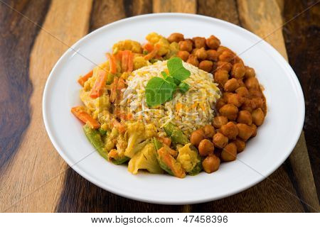 Vegetarian biryani rice or pilau rice with curry, fresh cooked basmati rice with spices, delicious Indian food.