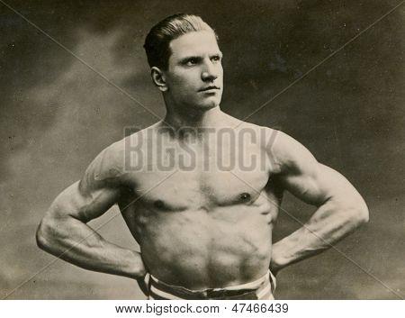 KALISZ, POLAND, CIRCA THIRTIES - vintage photo of muscular man with naked torso, Kalisz, Poland, circa thirties