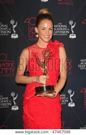 BEVERLY HILLS - JUN 16: Julie Marie Berman with the Outstanding Supporting Actress In A Drama Series award for 'General Hospital' - 40th Daytime Emmy Awards on June 16, 2013 in Beverly Hills, CA
