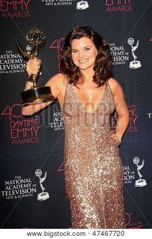 BEVERLY HILLS - JUN 16: Heather Tom with the Outstanding Lead Actress In A Drama Series award at the 40th Annual Daytime Emmy Awards at The Beverly Hilton Hotel on June 16, 2013 in Beverly Hills, CA