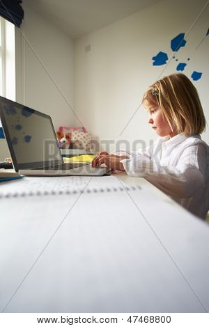 Girl Using Laptop In Bedroom