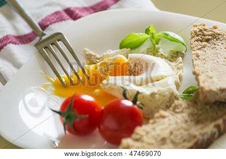 closeup of breakfast with eggs tomato