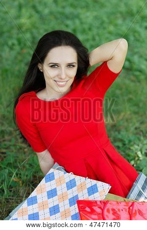 Young Woman with Shopping Bags Smiling