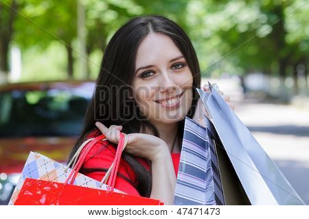 Young Woman with Shopping Bags Walking