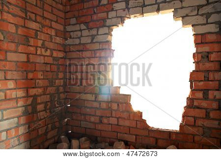 Broken bricks wall. Conceptual composition.