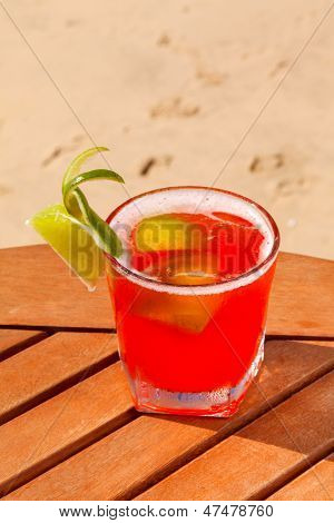 alcohol cocktail on the wooden table with crushed ice