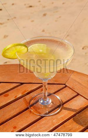 daiquiri cocktail with ice on the table against the background of sea